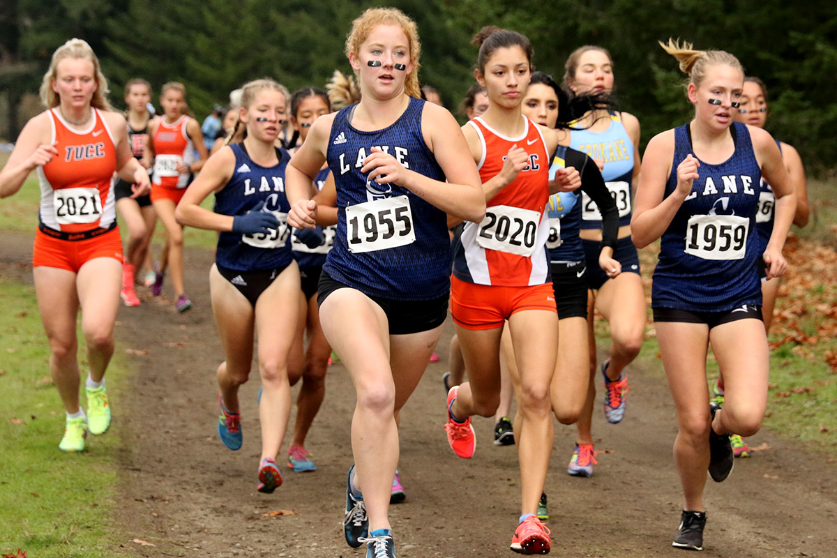 Photo of women's cross country runners in a pack.